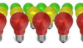 Row of red light bulbs in front of yellow and green ones — Стоковое фото