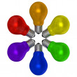 Many-colored light bulbs arranged in radial pattern — Stock Photo #39847641