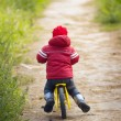 2-3 years old boy riding his balance bike — Stock Photo