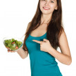 Woman eating a fresh salad — Stock Photo #34211929