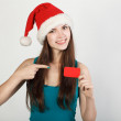 Girl in Santa hat — Stock Photo #34211933