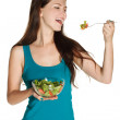 Woman eating a fresh salad — Stock Photo #34211937