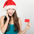 Girl in Santa hat — Stock Photo #34211939