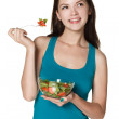 Stock Photo: Woman eating a fresh salad
