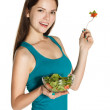 Woman eating a fresh salad — Stock Photo