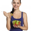 Woman eating fresh salad — Stok fotoğraf