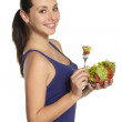 Woman eating fresh salad — Stock Photo