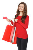 Woman hand with many shopping bags and credit card — Stock Photo