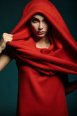Beautiful woman with red hood. Fashion. — Stock Photo