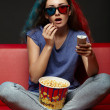 Beautiful girl watching movie with 3d glasses — Stock Photo