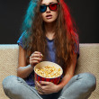 Beautiful girl watching movie with 3d glasses — Stock Photo #46545419