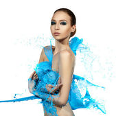 Sensual woman and big paint waves. Blue splash — Stock Photo