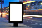 Blank bilboard at bus stop — Stock Photo