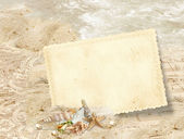 Peice of paper on the beach — Stock Photo