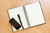 Notepad on the table — Stock Photo