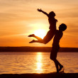 Young couple at sunset — Stock Photo