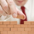 Building a brick wall — Stock Photo #36000443