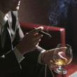 Stock Photo: Man, cognac and cigar
