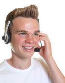 Smiling operator with blond hair — Stock Photo