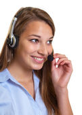 Attractive female operator at work — Stock Photo