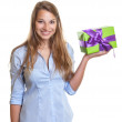 Young woman presents a christmas gift — Stock Photo