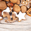 Christmas decoration with stars and rocking horse on wood — Stock Photo