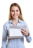 Laughing woman with letter in her hand — Stock Photo
