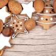 Three cinnamon stars with other christmas decoration — Stock Photo