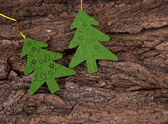 Two christmas trees on bark — Stock Photo