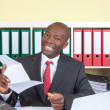 African businessman at office is happy about good news — Stock Photo