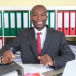 Laughing african businessman at his office — Stock Photo