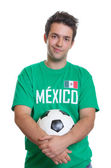 Smiling mexican football fan with ball — Stock Photo
