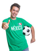 Laughing mexican soccer fan with ball showing thumb — Stock Photo