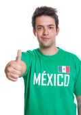 Smiling mexican sports fan showing thumb up — Stock Photo