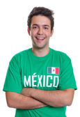 Laughing mexican sports fan with crossed arms — Stock Photo