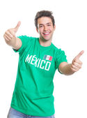 Laughing mexican sports fan showing both thumbs up — Stock Photo