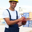 Smiling docker with freight papers — Stock Photo