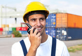 Docker on a seaport talking to a radio device — Stock Photo