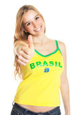 Brazilian sports fan showing thumb up — Stock Photo