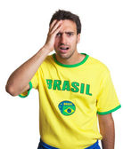 Shocked brazilian soccer fan — Stock Photo