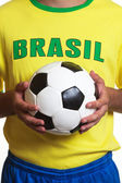 Brazilian soccer jersey with football — Stock fotografie