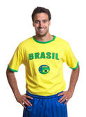 Attractive guy with brazilian jersey laughing at camera — Foto de Stock