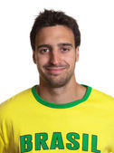 Portrait of an attractive guy with brazilian jersey — Zdjęcie stockowe