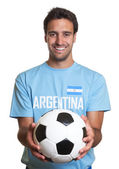 Laughing argentinian man with footbal — Stock Photo