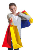Laughing woman showing her shopping bags — Stock Photo