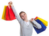 Laughing woman with 5 colorful shopping bags — Stock Photo