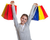 Cheering woman after shopping — Stock Photo
