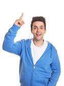 Hispanic guy pointing upwards — Stock Photo