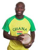Laughing sports fan from Ghana with drums — Stock Photo