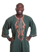 Standing african man with traditional clothes — Stock Photo